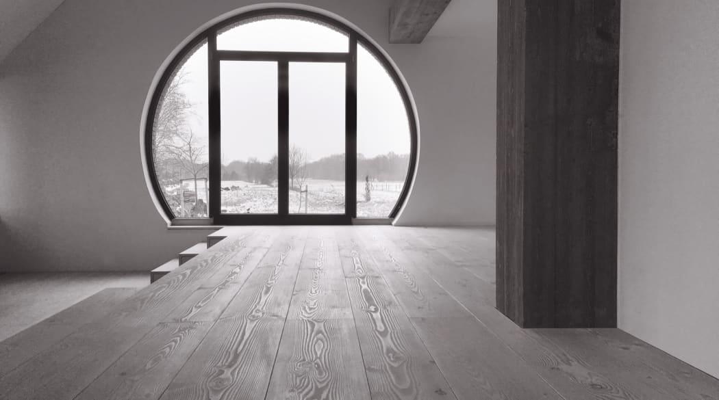 Thomas Kröger Architekt: im Inneren des Hauses am Deich mit Blick durch das runde Fenster